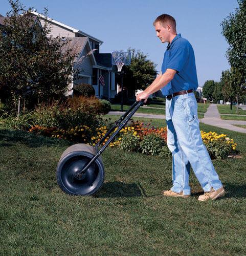 Man using lawn roller