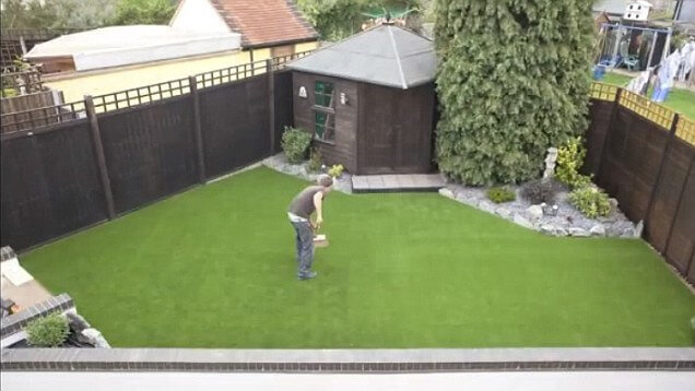 Man laying his own lawn